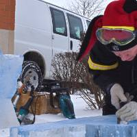 person chiseling ice